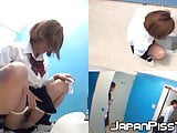 Three wicked Japanese schoolgirls peeing together in toilet